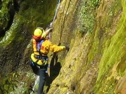 Firefighter climbs Salmon Creek Falls