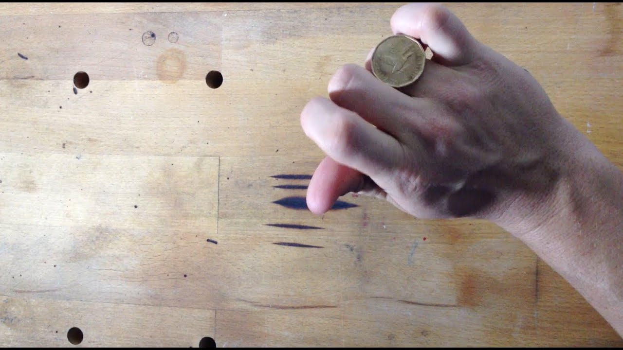 How to Roll a Coin on Your Knuckles