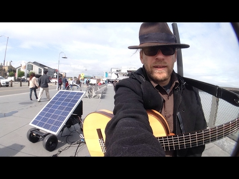 Street concert in San Francisco California Solar powered classical guitar