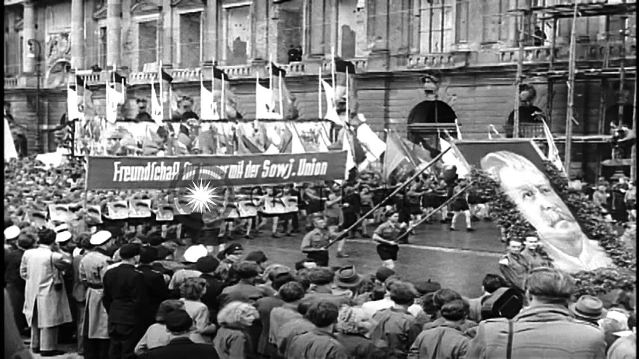 a rally by communist youth in berlin east germany hd. Black Bedroom Furniture Sets. Home Design Ideas
