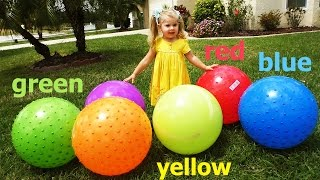 Diana plays with giant inflatable balls