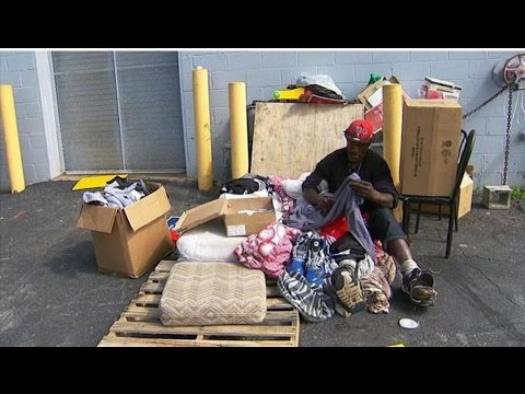 f69130743d99aa Dikembe Mutombo and Shaquille O Neal donate clothes to homeless man ...