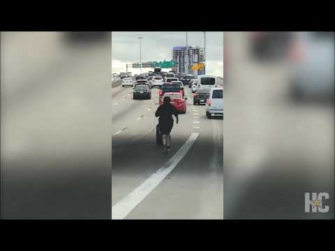 A.J. - Man Chases Rolling Tire Down Busy Interstate In Houston!