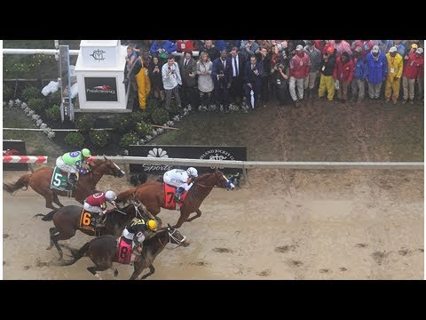 Justify charges through thick fog and mud to win Preakness Stakes and set stage for Triple Crown bid