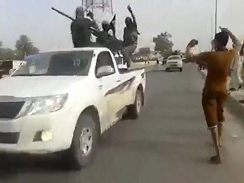 Raw: ISIL Militants Parade Through Beiji