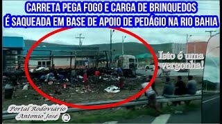 Carreta pega fogo e carga de brinquedos é saqueada em base de apoio de pedágio na Rio Bahia