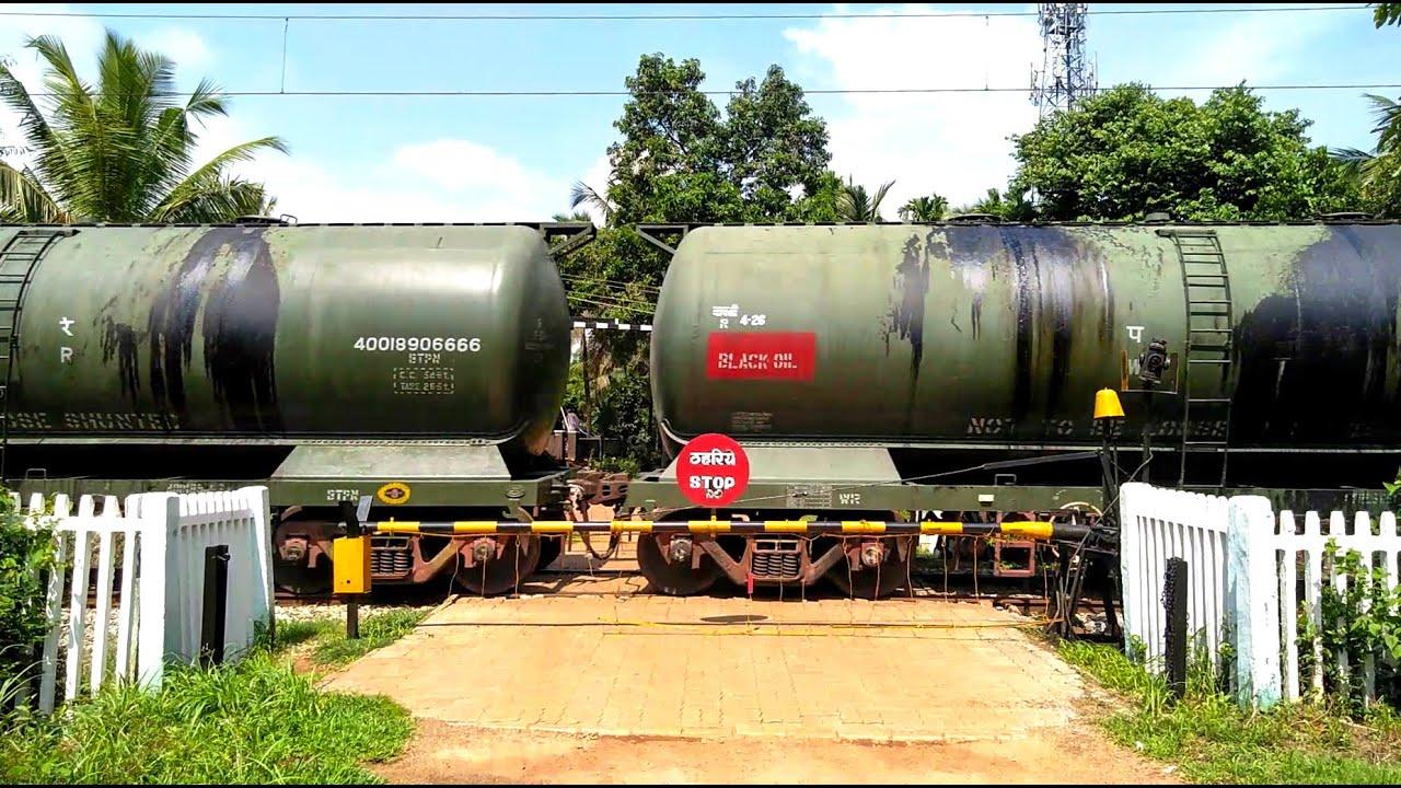 An Oil Tanker Train Passing Through A Rural Railroad/Level Crossing