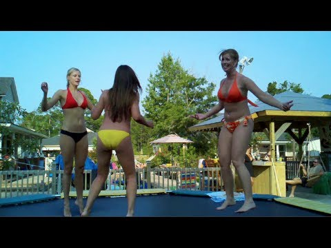 Girls jumping on trampolines