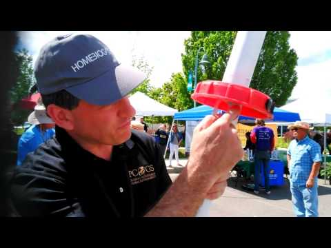 Showing the gas out pipe on a Solar CITIES IBC biodigester in Redding, CA Earth Day festival