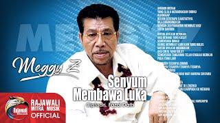 Download Meggy Z. - Senyum Membawa Luka (Official Music Video)