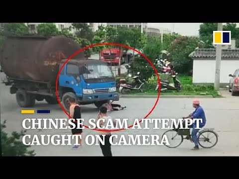 Nick Wize - A Woman Attempts an Insurance Scam by Throwing Her Bike at a Truck
