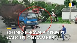 Chinese woman caught on video in apparent attempt to scam truck driver