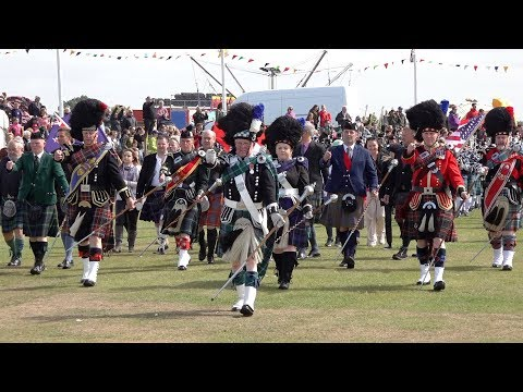 Massed Pipes & Drums parade through town to start the 2018 Nairn Royal Brackla Highland Games