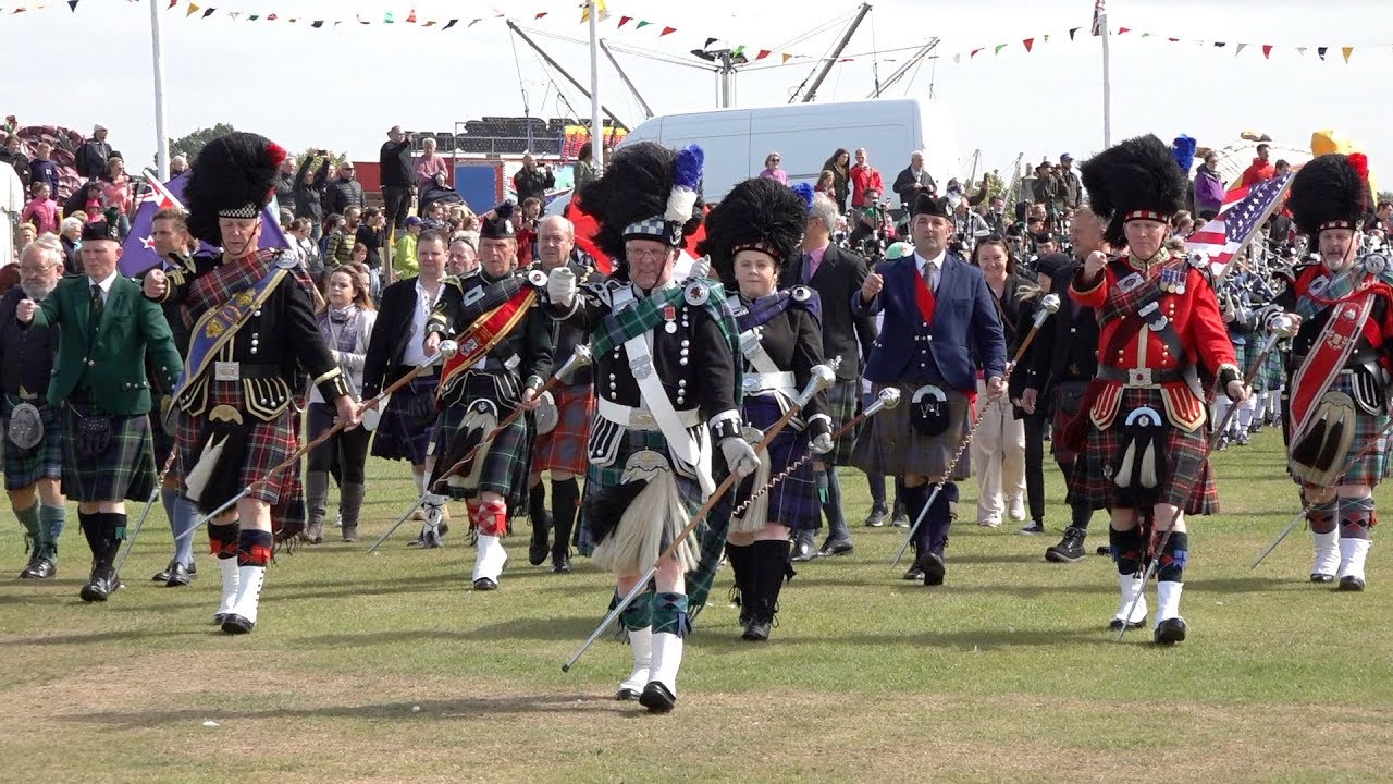 Download Massed Pipes & Drums parade through town to start the 2018 Nairn Royal Brackla Highland Games