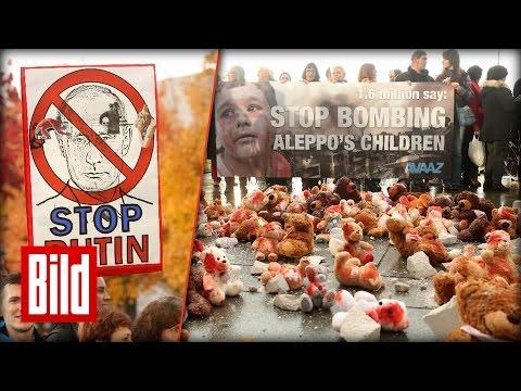 Putin in Berlin: Blutige Kuscheltiere als Protest (Aleppo/Ukraine)