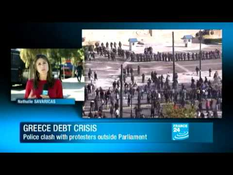 Greece - Police clash with protesters outside Greek parliament