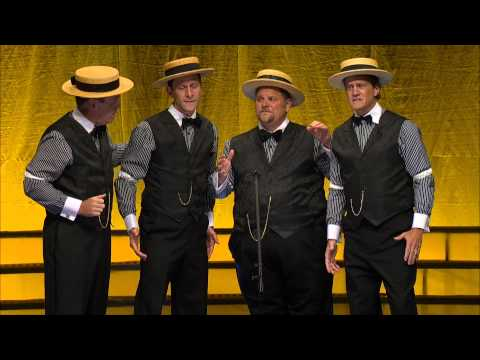 Barbershop quartet makes fun of modern pop songs in their international competition performance