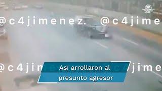 En las imágenes se ve a la camioneta que acelera y arrastra la motocicleta y a un presunto agresor por la avenida; algunos autos se detuvieron cuando comenzó la balacera cerca del AICM