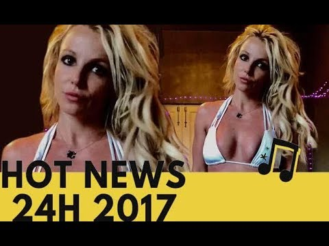 Britney Spears shows off her cleavage and washboard abs thumbnail