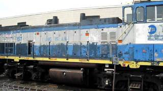 LIRR MP15AC 157 idles at a siding in LIC