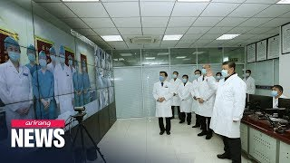 China's death toll from coronavirus surpasses 1,000; Xi makes first visit to hospital