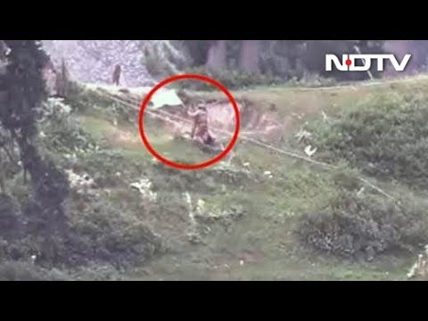 Video Shows Pak Soldiers With White Flags Retrieve Bodies Near LoC