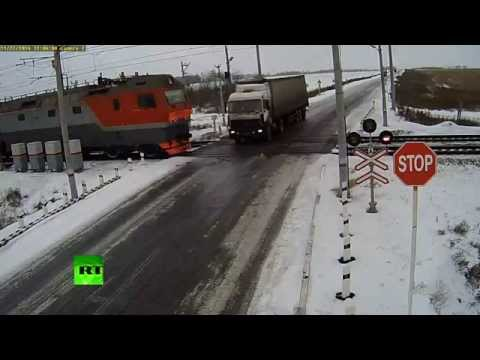 Thumbnail: Truck torn apart by two trains at rail crossing in Kazakhstan