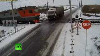 Truck torn apart by two trains at rail crossing in Kazakhstan