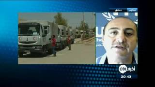 قافلة مساعدات تدخل حي الوعر