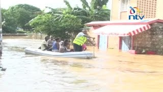 Parts of Mombasa County submerged, residents using boats in estates