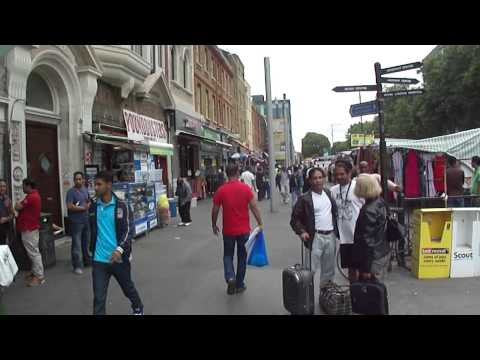 Walking along Whitechapel Road Street Market, London, UK; Tuesday 21st August 2012