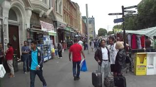 Walking along Whitechapel Road Street Market, London, UK; Tuesday 21st August 2012