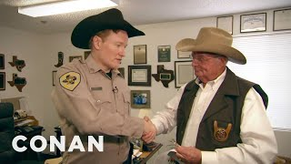 Conan goes to Johnson County to pursue a career in law enforcement. He just needs to pass a few tests... [See it in CONAN360° @ http://bit.ly/1llHwnJ] Team ...