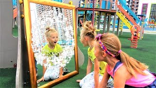 Kids playing with Magic Mirror on the Playground