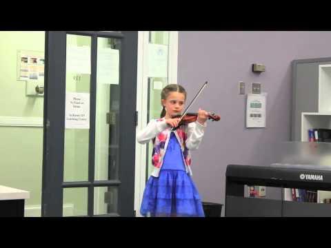 Ellie playing at the Kangaroo Math Awards Ceremony