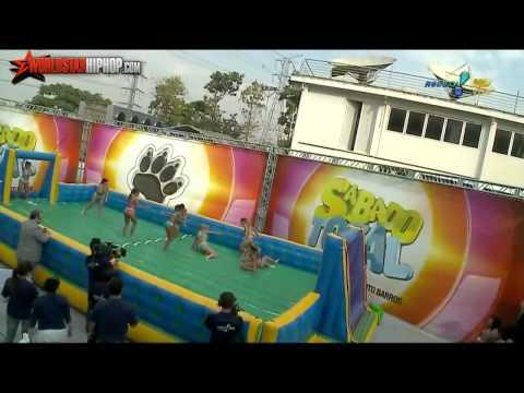 Brazilian Women Playing Slip N Slide Soccer