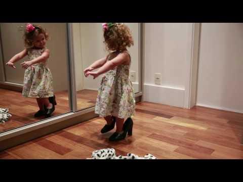 Little Girl Dances in Front of Mirror