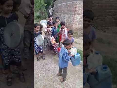 Slum kids doing Ganpati Visarjan