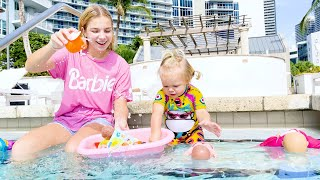 Maggie swimming with little Naomi