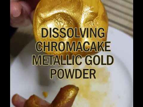Dissolving Metallic Gold Food Colouring Powder in Water - YouTube
