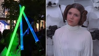 'Star Wars' Fans Pay Tribute To Carrie Fisher With Lightsaber Vigil