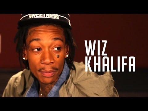 Wiz Khalifa shows off new tattoos & talks Snoop's support at Summer Jam