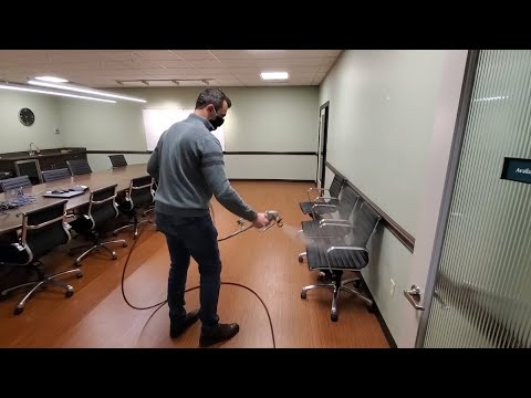 Spraying Disinfectant With A Paint Sprayer In A Office Building