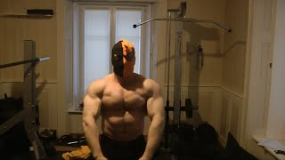 Massive Bodybuilder Pumping Muscle Bicep