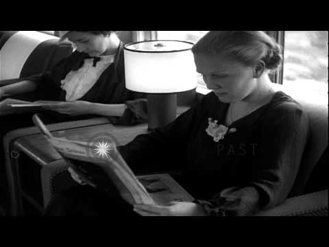 People read newspaper and at tables for a meal aboard a luxurious train in Chicag...HD Stock Footage