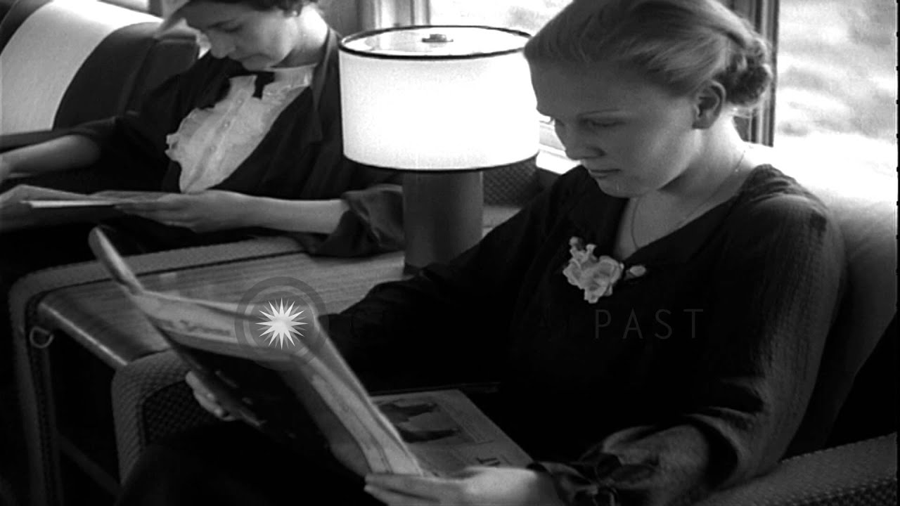 people read newspaper and at tables for a meal aboard a luxurious