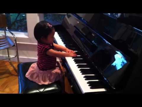 Download Georgie playing piano