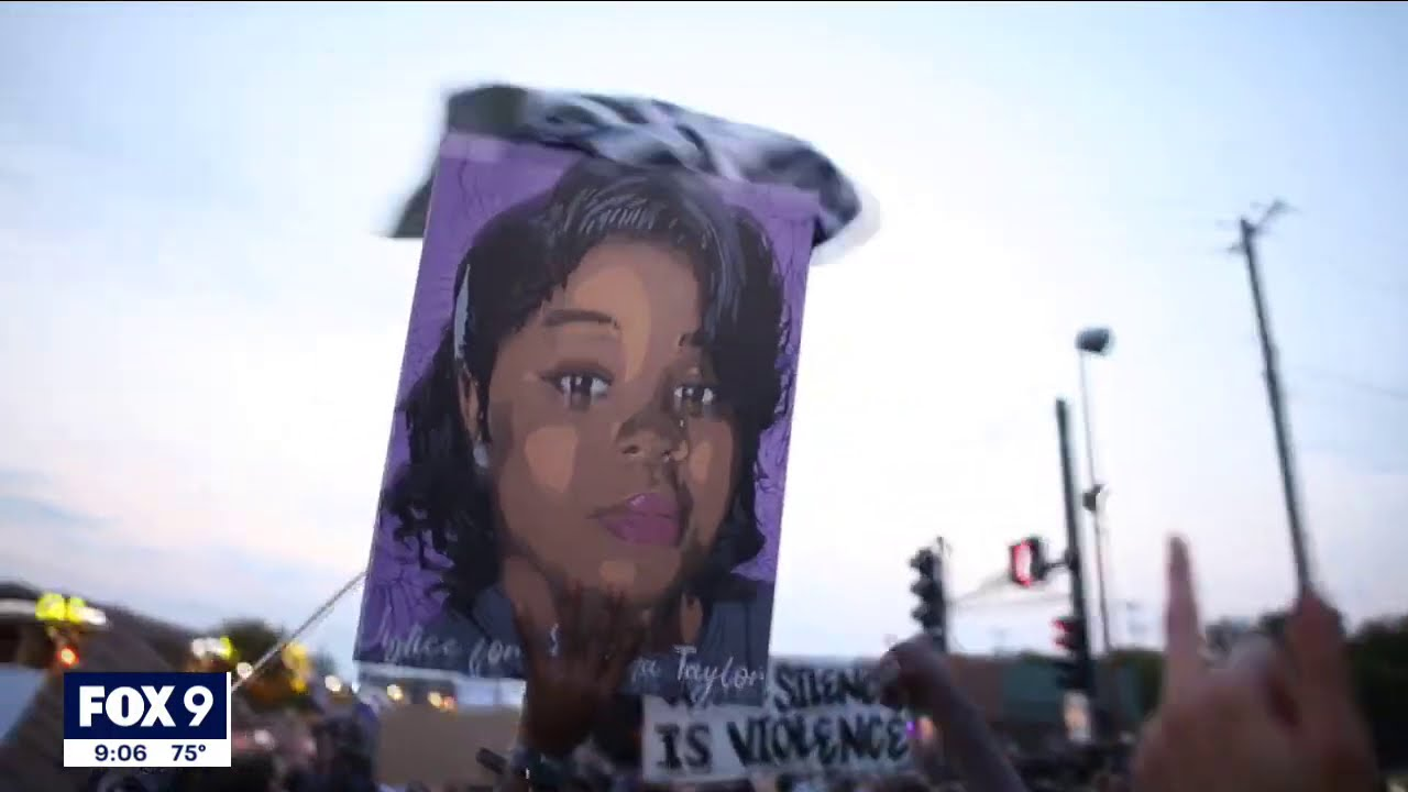 Protesters march on I-94 in St. Paul, Minnesota following charging decision in Breonna Taylor case