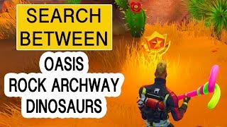 SEARCH BETWEEN AN OASIS ROCK ARCHWAY AND DINOSAURS - SEASON 5 WEEK 2 - FREE BATTLESTAR - FORTNITE BR
