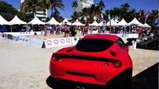 Sexy models and the sexy 2012 Lotus Evora at the Model Beach Volleyball Tournament, Miami Beach